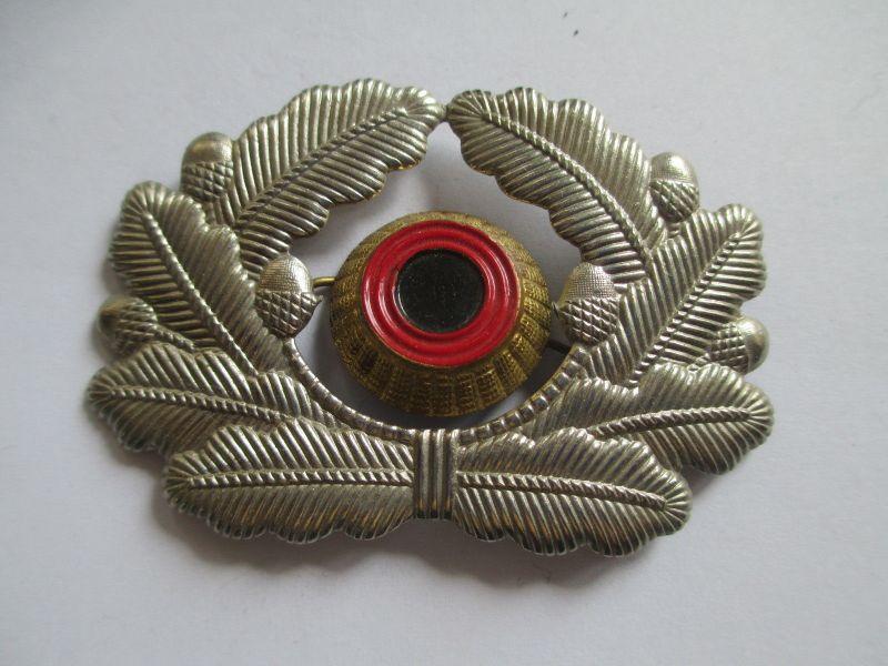 NVA Mützenkokade für Offiziere mit Übergangskokade NVA zur BW