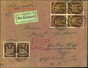 1923, 25 Mk Holzstaube im Viererblock und Paar auf Luftpostbrief ab LEIPZIG mit Flugbestätigungsstempel nach Berlin.