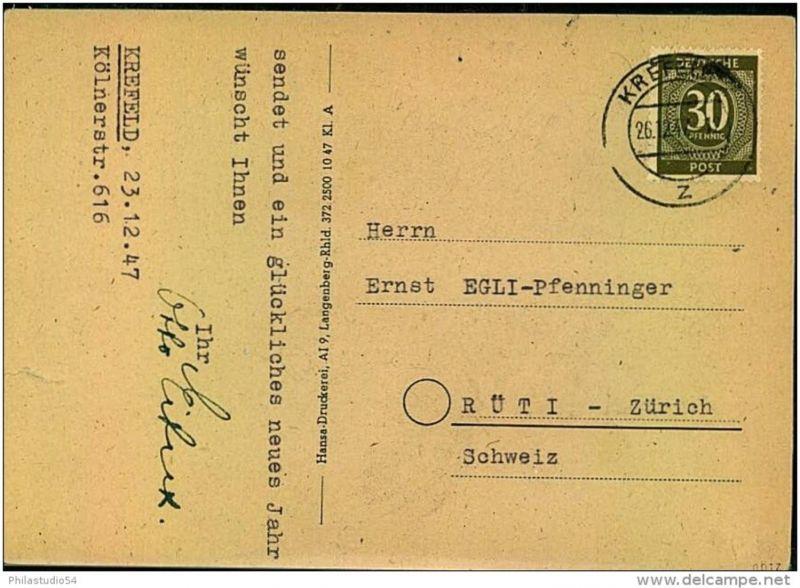 1947: Auslandskarte mit EF 30 Pfg. Ziffer ab KREFELD in die Schweiz.
