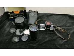E499/ Olympus OM 10 Kamera mit Zuiko 35mm und Tokina 80 - 200 mm Objektiven
