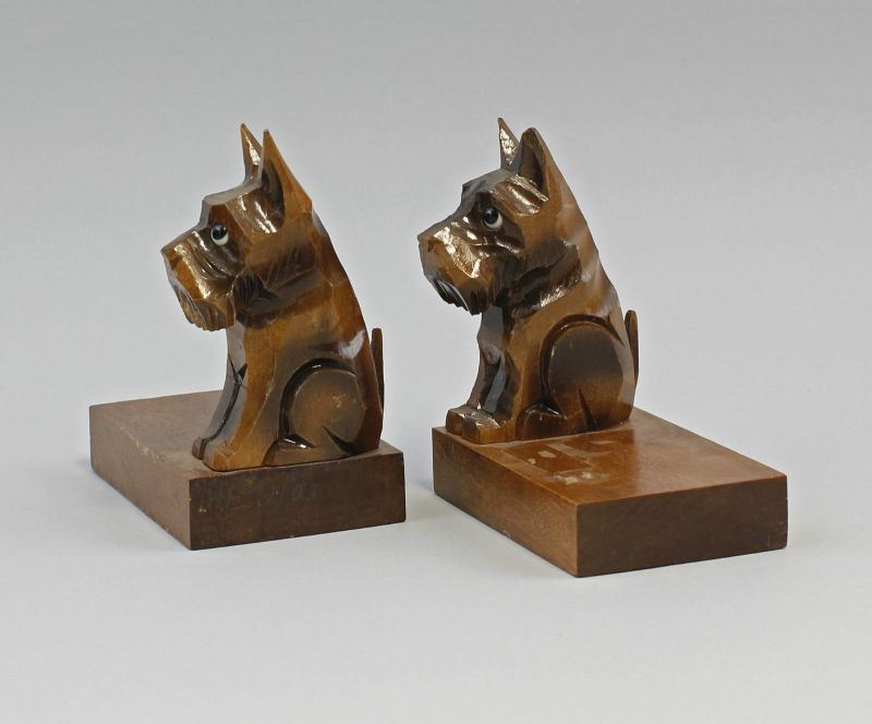 Paar figürliche Buchstützen Hunde Holz beschnitzt 99838047