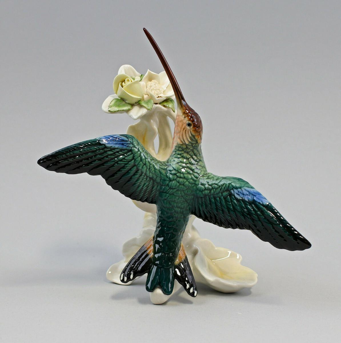 9959548 Porzellan Figur Kolibri fliegend mit Blüte gelb/weiß  Vogel Ens H18cm