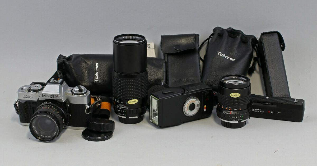 8470006 Spiegelreflexkamera Minolta XG-1 mit Zubehör 3 Objektive Tokina Foto 0