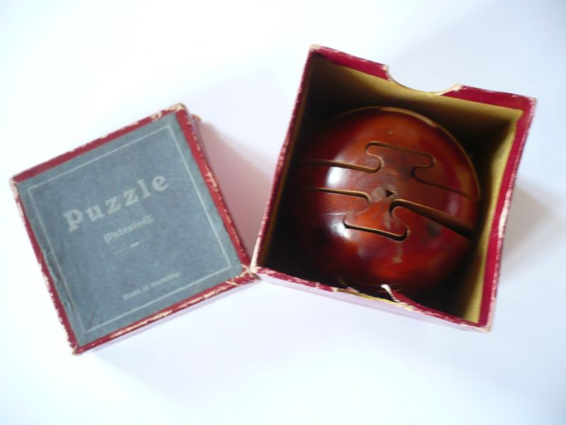 Holzkugel Puzzle in org. Karton (533)