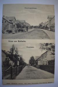 Ak Gruss aus Mallmitz, Eisenbergerstraße u. Neustrasse 1912 gelaufen Bahnpost