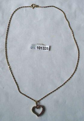 Schöner Kette 333er Gold Anhänger mit Herz mit roten Edelsteinen (101325)