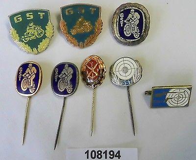 8 verschiedene DDR Abzeichen GST Gesellschaft für Sport und Technik (108194)