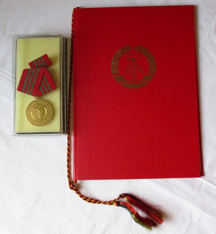 DDR Verdienstmedaille der Zollverwaltung in Gold im Etui + Urkunde (120370)