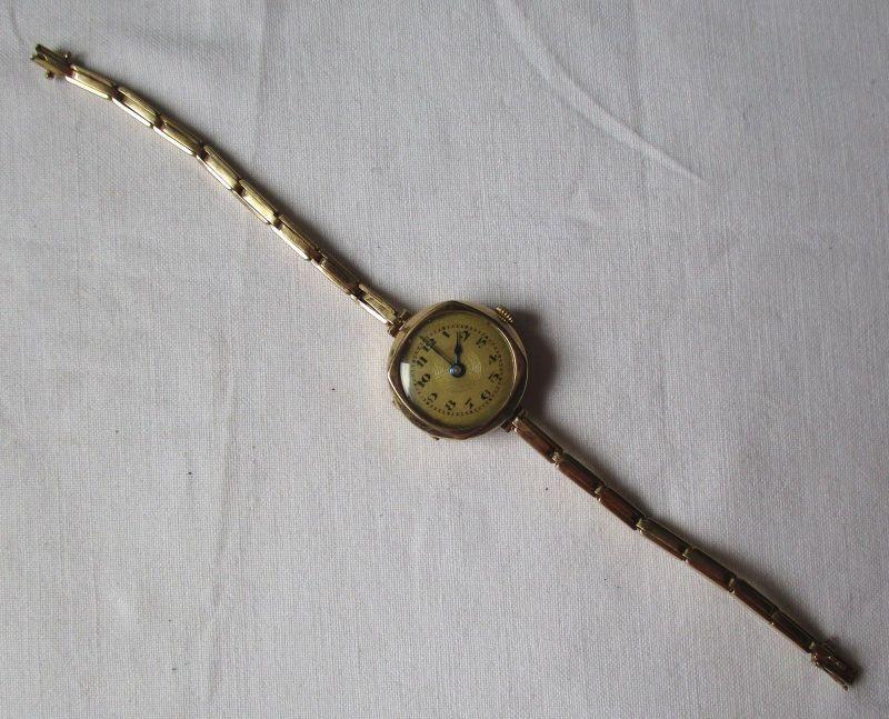 Schöne Damen Armbanduhr 585er Gold 14 K mit Armband aus 585er Gold (123355)