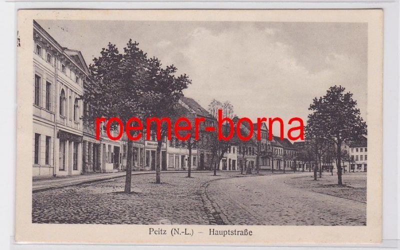 82287 Ak Peitz N.-L. (Picnjo) Hauptstraße mit Geschäften 1928