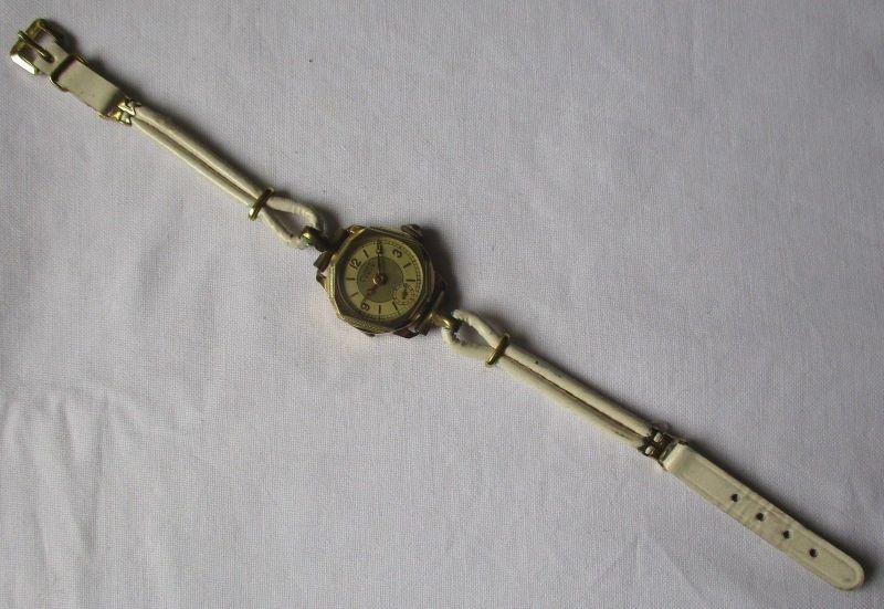 Schöne Mugea Luxus Damen Armbanduhr 585er Gold mit weißem Armband (106204)