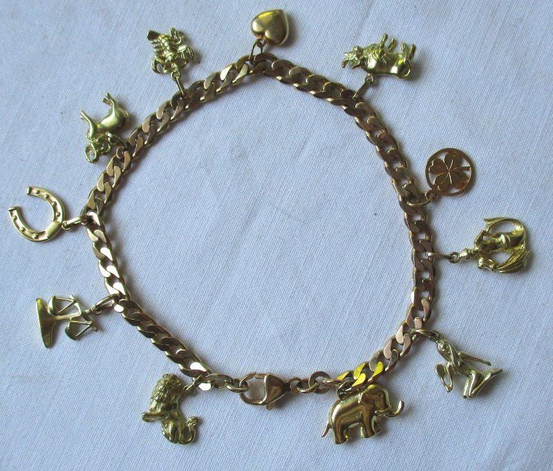 Bettelarmband - CHARMS - 333er Gold 16,3 Gramm mit 11 Anhängern L21,5 cm(124624)