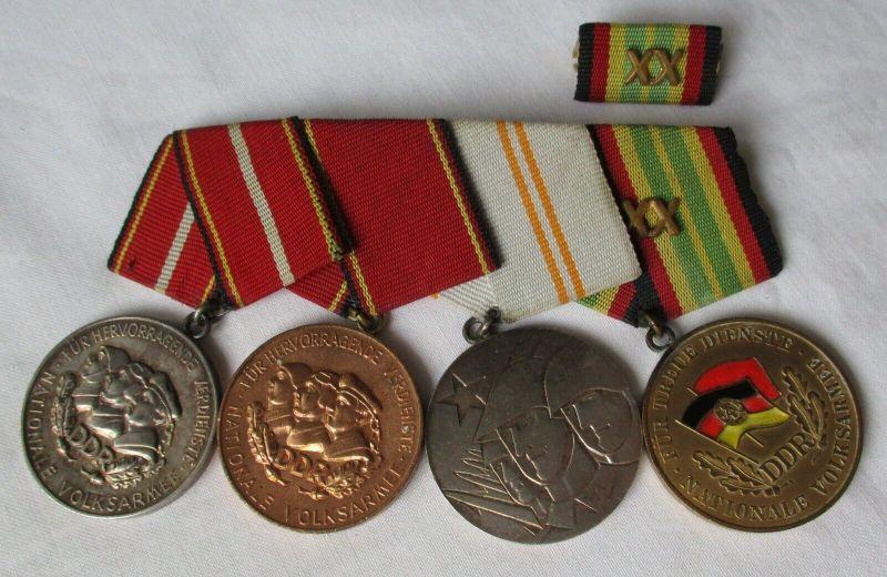 DDR Ordensspange NVA mit 4 Orden einer aus 900er Silber (129109)