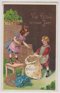 70645 Neujahrs Ak Kinder verpacken Goldmünzen in Säcke um 1910