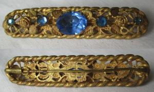 Elegante goldfarbene Brosche mit blauen Schmucksteinen (130515)