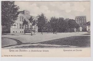 91148 Ak Gruß aus Malchin Gymnasium und Steintor um 1910