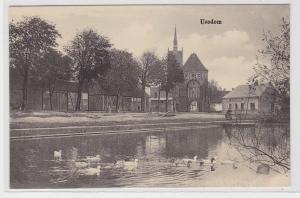 90931 Ak Usedom Kirche und Dorfteich um 1920