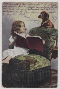 89958 Künstler AK Kind im Sessel hält Dackel Buch zum Vorlesen hin 1903