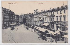 89854 Ak Beuthen in Oberschlesien Boulevard mit Geschäften um 1910
