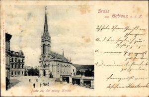 Ak Jablonec nad Nisou Gablonz an der Neiße, Platz bei der ev. Kirche