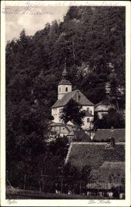 Ak Oybin in Sachsen, Blick auf die Kirche über Häuser hinweg, Wald