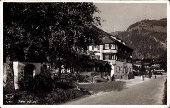 Ak Bayrischzell im Mangfallgebirge Oberbayern, Straßenpartie, Hotel Alpenrose
