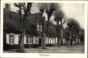 Ak Mogeltonder Dänemark, Straßenpartie mit Blick auf Häuser mit Reetdach