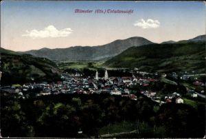 Ak Munster Münster Elsaß Haut Rhin, Totalansicht der Stadt, Kirchturm, Berge