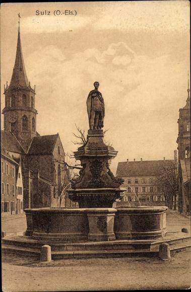 Ak Soultz Haut Rhin Sulz Elsass Haut Rhin, Blick auf ein Denkmal, Kirchturm