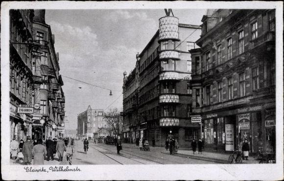 Ak Gliwice Gleiwitz Schlesien, Wilhelmstraße, Geschäft Theodor Janetzko, Geschäfte, Passanten