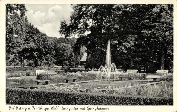 Ak Bad Driburg im Kreis Höxter, Partie am Springbrunnen im ...