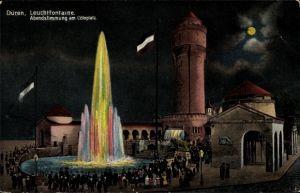 Künstler Ak Düren in Nordrhein Westfalen, Leuchtfontäne, Abendstimmung am Cölnplatz