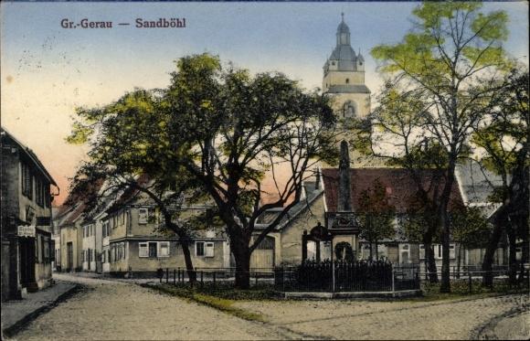 Ak Groß Gerau in Hessen, Sandböhl, Straßenpartie, Kriegerdenkmal, Kirchturm