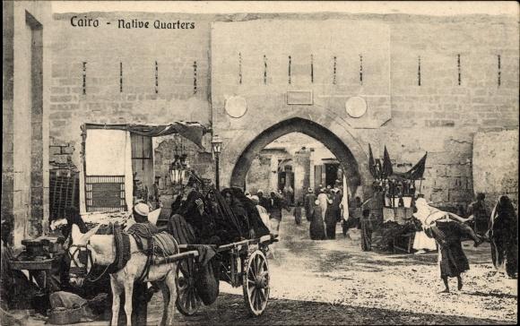 Ak Cairo Kairo Ägypten, Native Quarters, Straßenpartie, Tor, Eselskarren