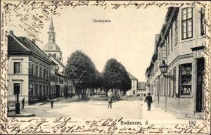 Ak Bockenem in Niedersachsen, Marktplatz mit Blick zur Kirche, Geschäftshaus, Passanten