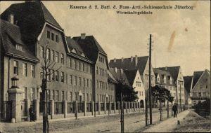 Ak Jüterbog, Kaserne des 2. Batl. d. Fuß Artillerie Schießschule, Wirtschaftsgebäude, Straßenansicht