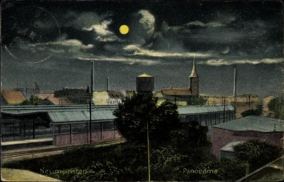Ak Neumünster in Schleswig Holstein, Nachtszene, Panorama mit Bahnhof