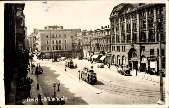 Foto Ak Poznań Posen, Wilhelmstraße, Straßenbahnen, Geschäft Przewodnik Katolicki