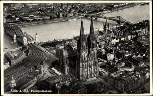 Ak Köln am Rhein, Teilansicht der Stadt mit Kölner Dom und Rheinbrücken, Fliegeraufnahme