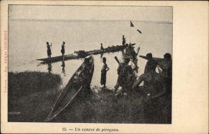 Ak Un coin de pirogues, Afrikaner mit Booten an einem Ufer