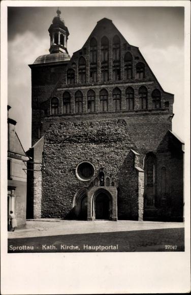 Ak Szprotawa Sprottau Schlesien, Katholische Kirche, Hauptportal, Kosciol