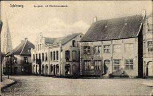 Ak Schleswig in Schleswig Holstein, Langestraße mit Altertumsmuseum, Geschäft Hermann Wachhollz