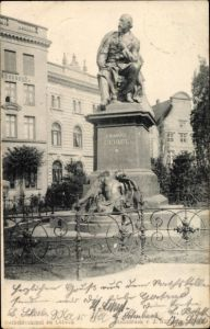 Ak Lübeck in Schleswig Holstein, Denkmal Emanuel Geibel, Grünanlagen, Gebäude