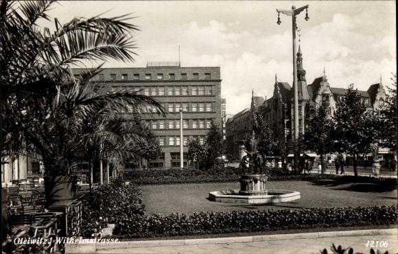 Ak Gliwice Gleiwitz Schlesien, Wilhelmstraße, Straßenpartie, Fontäne