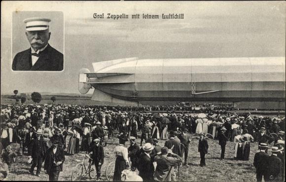 Ak Graf Zeppelin mit seinem Luftschiff, Starrluftschiff auf einem Feld, Zuschauer