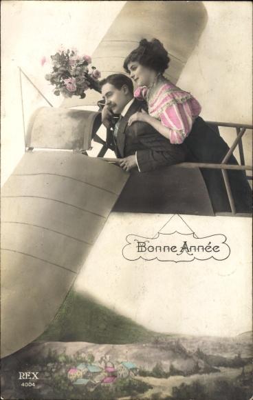 Ak Glückwunsch Neujahr, Bonne Année, Liebespaar in einem Flugzeug, Fotomontage