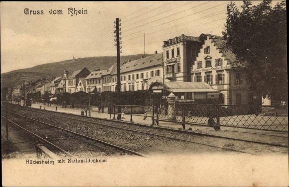 Ak Rüdesheim am Rhein in Hessen, Blick auf den Bahnhof, Gasthaus zur Krone, Inh. L. Bocher