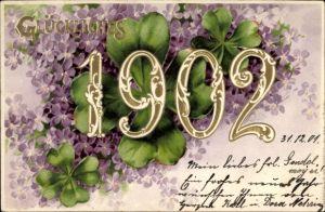 Präge Litho Glückwunsch Neujahr, Jahreszahl 1902, Kleeblätter, Veilchenblüten