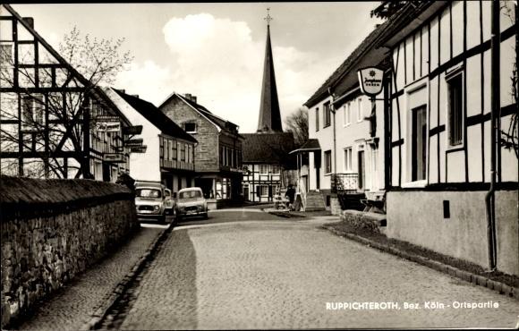 Ak Ruppichteroth in Nordrhein Westfalen, Partie im Ort, Fachwerkhäuser, Autos, Junghans Uhren