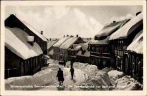Ak Benneckenstein Oberharz am Brocken, Partie auf der Bahnhofstraße vor den zwei Löwen, Winter